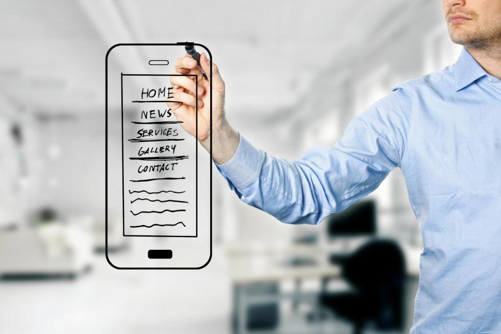 designer drawing mobile website development wireframe